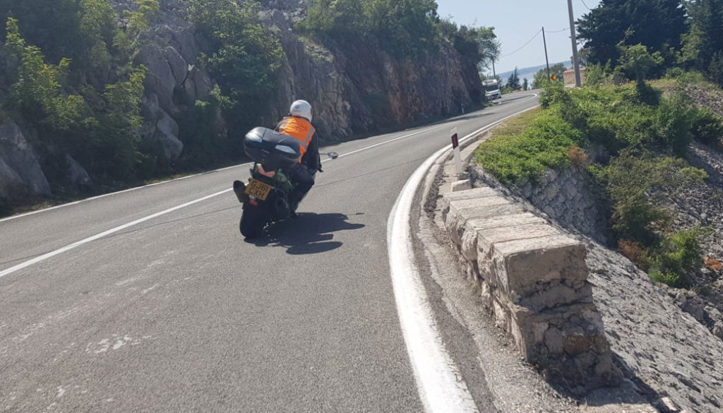 Motorcyclist cornering with ease